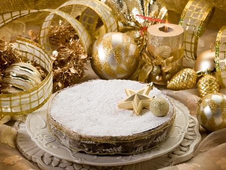 Christmas cake over golden table photo