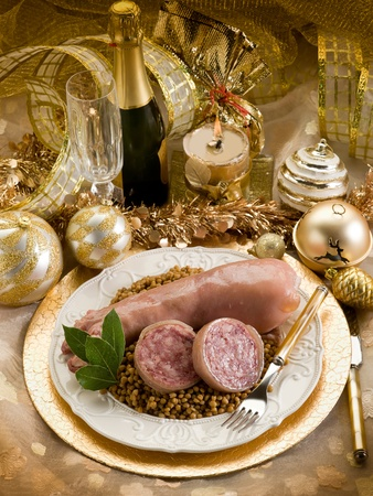 pig trotter with lentils over golden christmas table photo