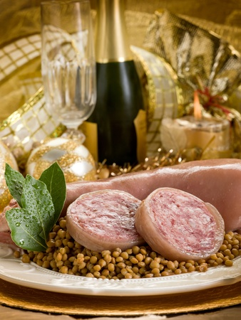 pig trotter with lentils over golden christmas table