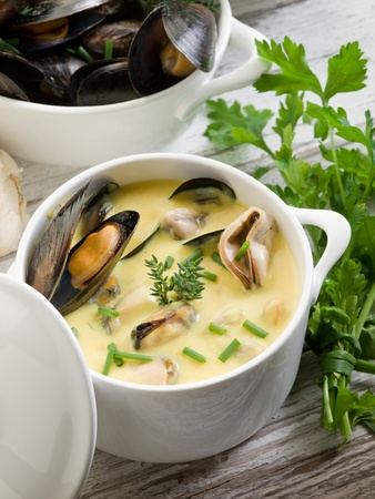 mussel soup with saffron and cream sauce photo