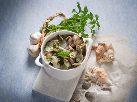 clam soup with garlic and parsley photo