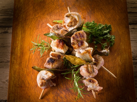 bbq chicken: mixed meat skewer on wooden background Stock Photo