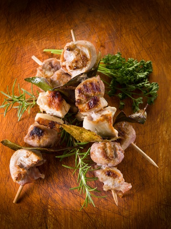 shish: mixed meat skewer on wooden background Stock Photo