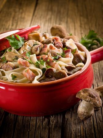 cep: tagliatelle with cep edible mushroom and bacon over casserole