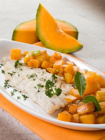 cod fish: cod fillet with stewed pumkin Stock Photo