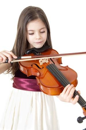 violist: klein meisje spelen viool Stockfoto
