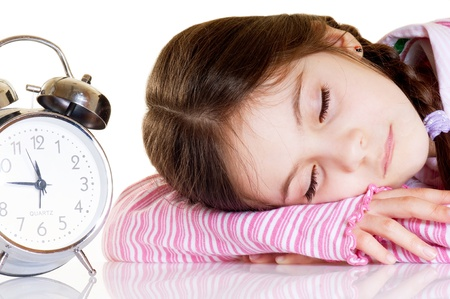 little girl with alarm clock photo