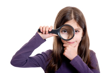 investigating: Girl holding magnifying glass Stock Photo