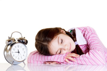 little girl with alarm clock photo