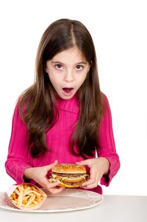 surprise little girl looking hamburger  Stock Photo - 11727789
