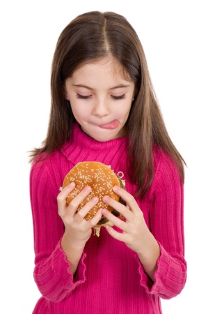 little girl eating hamburger on withe background Stock Photo - 11731519