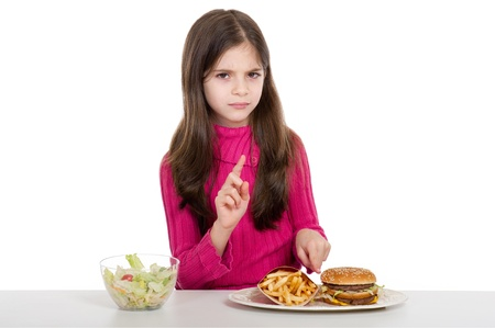 child food: little girl with healthy and unhealthy food