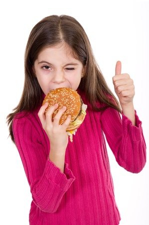 big mouth: little girl eating hamburger on withe background