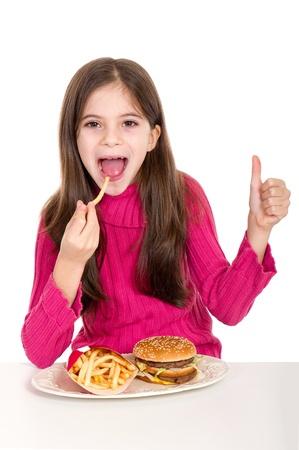 little girl eating hamburger on withe background photo