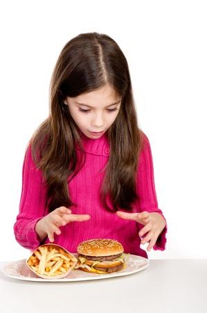 surprise little girl looking hamburger  photo