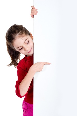 leeg bord: meisje wijst fingher over het houden van leeg bord Stockfoto