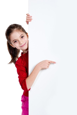 girl pointing fingher on holding empty board photo