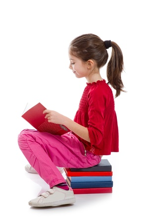 little girl reading book Stock Photo - 11726410