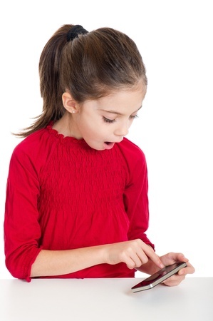 preteens girl: little girl play with the smartphone