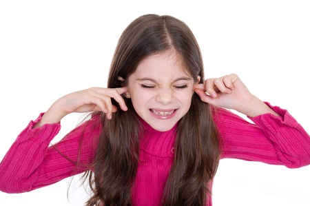 covering the face: Girl putting finger on her ears Stock Photo