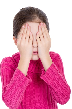 covering eyes: Young little girl covering eyes Stock Photo