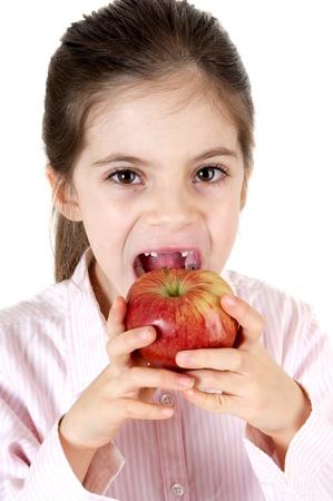 little girl eating apple Stock Photo - 11735914