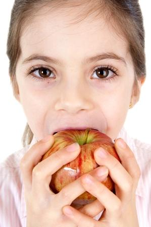 little girl eating apple photo