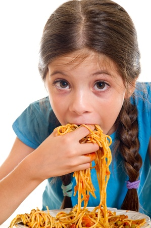 eating pasta: cute little girl eating spaghetti