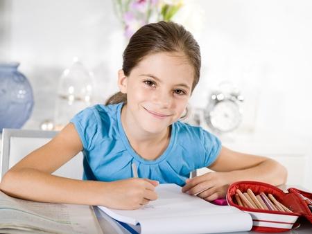 study desk: little girl studying