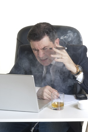 manager smoking cigar at workplace photo