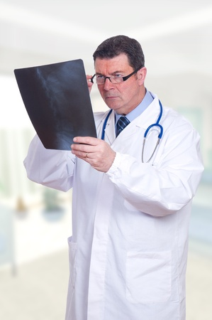 doctor at the hospital looking x-ray photo