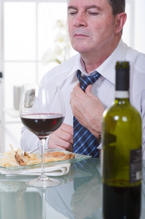 man at restaurant with red wine photo