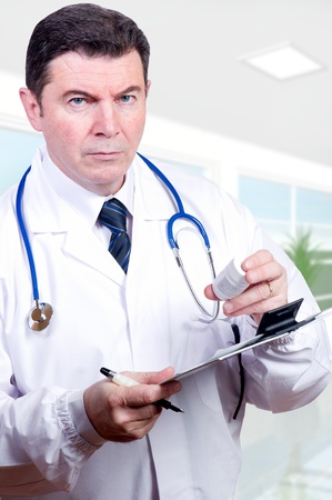 serious doctor: serious doctor with pills at hospital