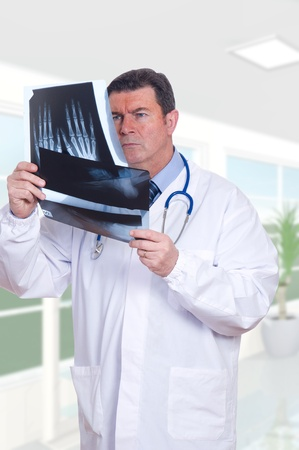 doctor looking x-ray photo
