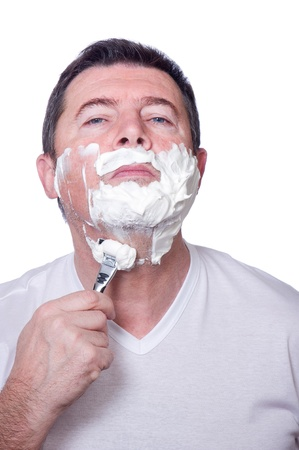 man shaving beard photo
