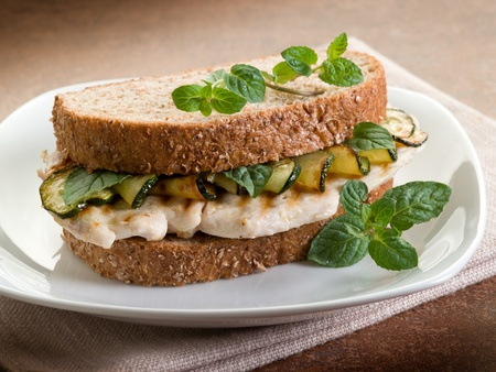 sandwich with grilled chicken and sauteed zucchinis photo