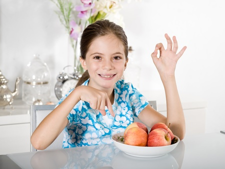 little girl with red apple photo