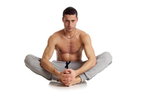 man meditating: man on yoga position