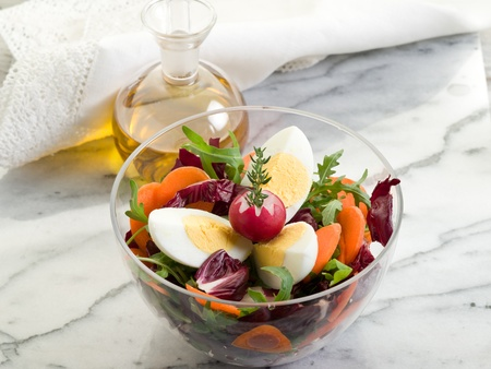mixed salad with arugula carrot and egg photo