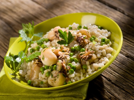 barley risotto with sepia and beans photo
