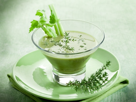 thymus: Celery cream soup with thymus on glass Stock Photo