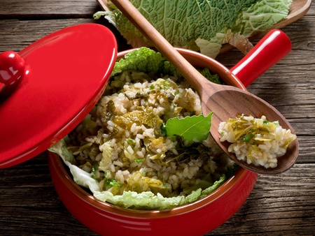 risotto with savoy cabbage in red casserole photo