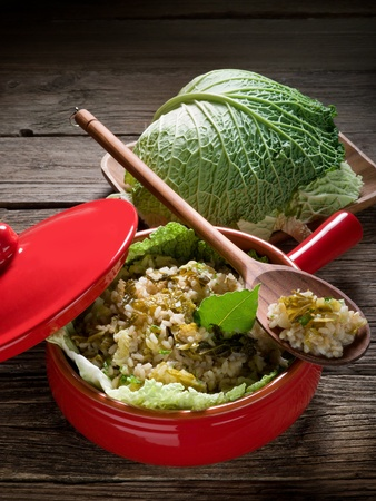 savoy: risotto with savoy cabbage in red casserole Stock Photo