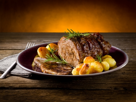 beef cuts: roast of veal with potatoes
