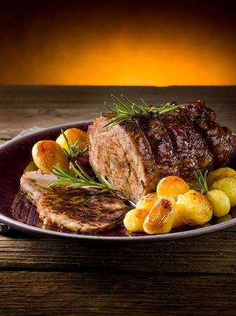 roast lamb: roast of veal with potatoes