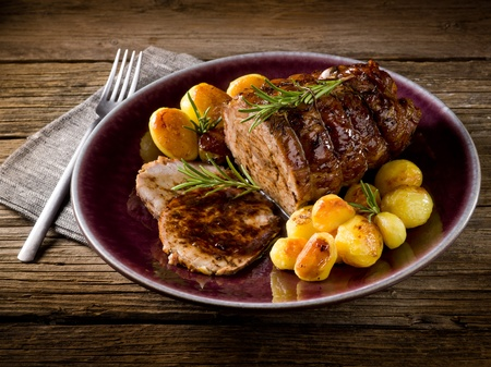 roast of veal with potatoes photo