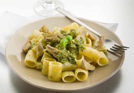 artichoke: pasta with pesto and artichoke over steel background Stock Photo