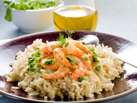 risotto: brown rice with shrimp and arugula pesto Stock Photo