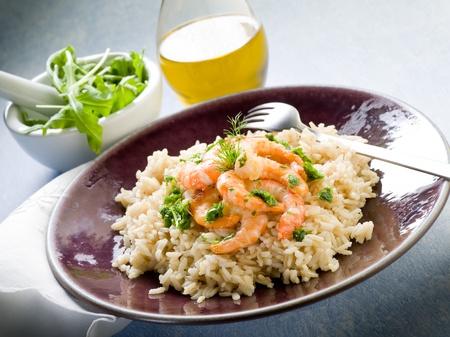 brown rice: brown rice with shrimp and arugula pesto Stock Photo