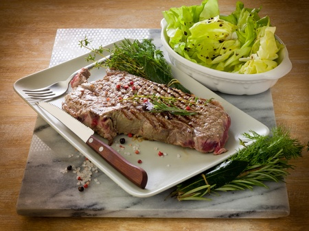 tbone: grilled t-bone with green salad Stock Photo